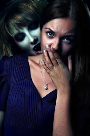 scary vampire biting a frightened girl at night photo