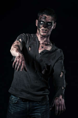 The zombie in browm shirt in the studio photo