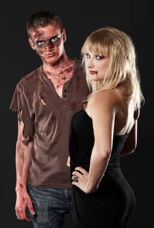 zombie and vampire are serious in the studio photo