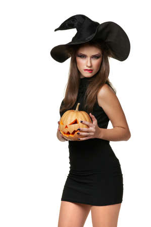 The brunette woman in a black dress with a pumpkin photo