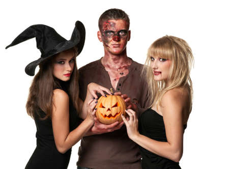 happy halloween: vampire, zombie and witch holding a pumpkin isolated
