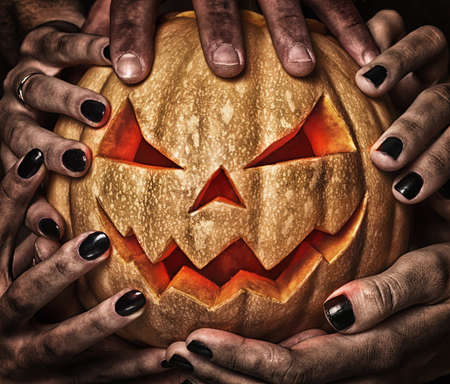 evil pumpkin with glowing eyes that are holding, closeup Stock Photo - 16239813