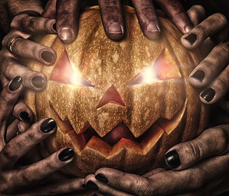 evil pumpkin with glowing eyes that are holding, closeup Stock Photo - 16239785