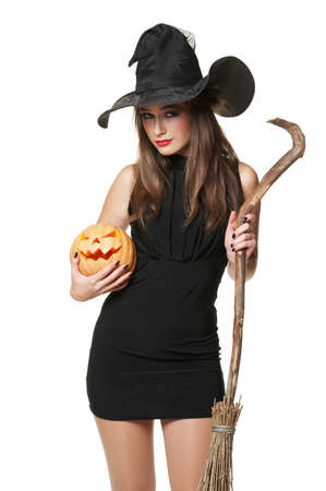 The  nice witch with a broom and pumpkin photo