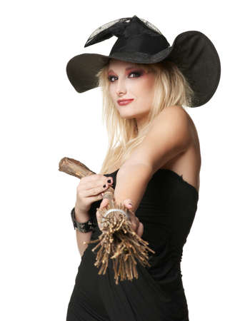 The  young blonde witch with a broom in a black dress photo