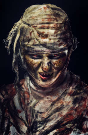mummified: portrait of scary bad mummy at night