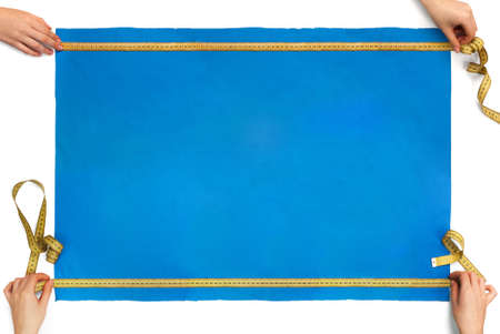 measures the size of a piece of blue cloth with a ruler Stock Photo - 17471871