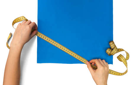 measures the size of a piece of blue cloth with a ruler Stock Photo - 17471812