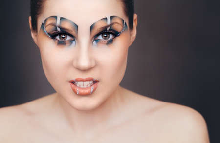 full face: make-up in the style of the Raptor full face Stock Photo