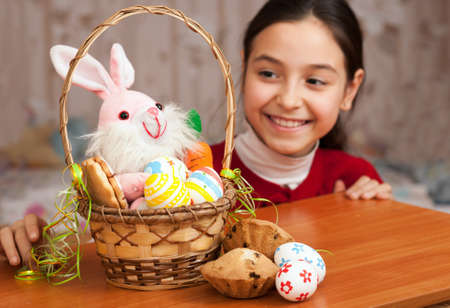 Beautiful teen girl with a basket of Easter eggs photo