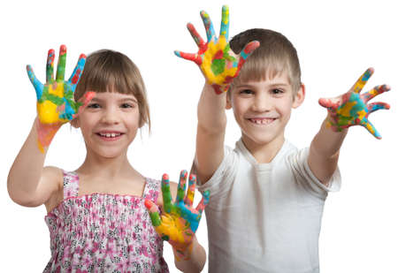 boy and girl show their hands soiled in a paint