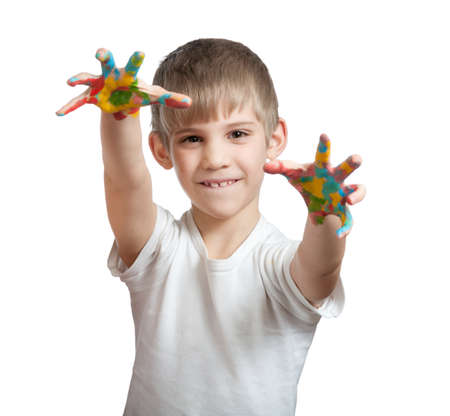 smeared hand: boy shows his hand smeared in paint, isolated on white