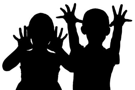 Silhouette frightening children who raised their hands Stock Photo