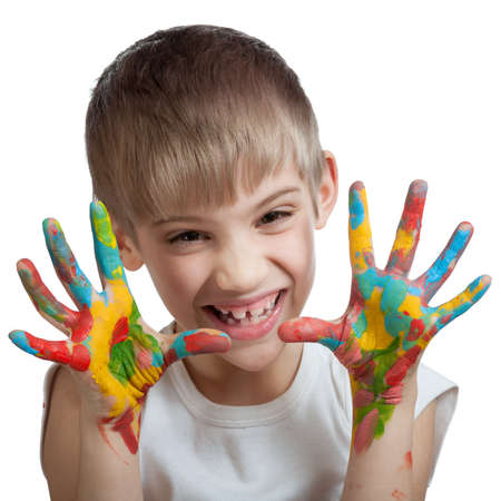 smeared hand: Boy scares his soiled hands in different colors