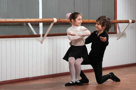 leotard: Boy and girl dancing in a ballet barre