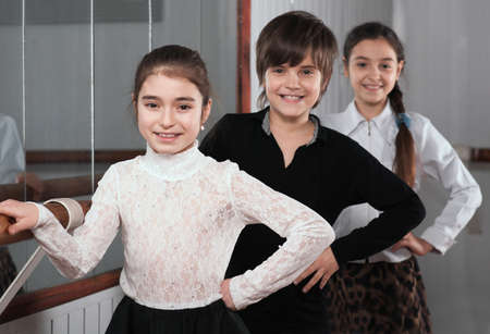 barre: happy children standing near a ballet barre Stock Photo