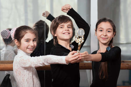 Three young dancers won the cup photo