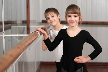 funny children standing at ballet barre photo