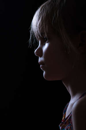 little girl crying in the dark photo