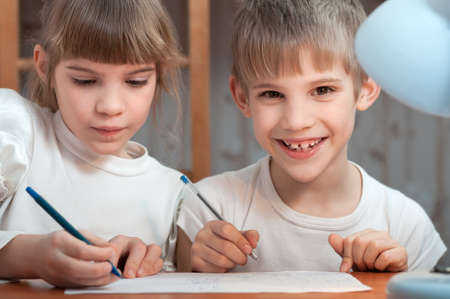 kids drawing pen on paper Stock Photo - 18453697