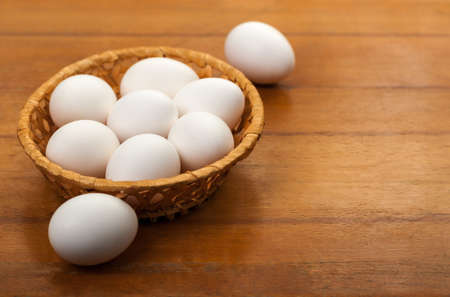 Easter eggs in a wicker bowl photo