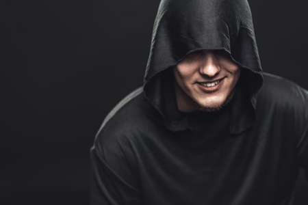 Smiling guy in a black robe photo