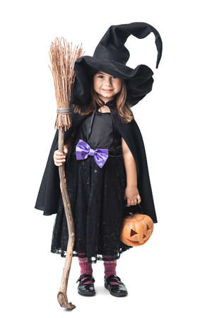 witch on broom: little witch with a broom and pumpkin on a white background