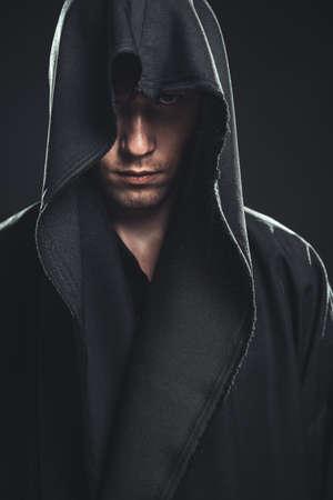 seus guy in a black robe Stock Photo - 22608219