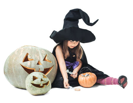 considers: little witch sits near tykov and considers candies