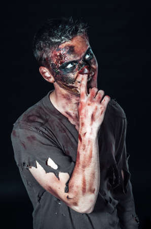 madman: scary zombie picks his nose Stock Photo