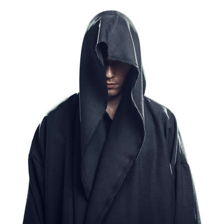 a white robe: Portrait of a Man in a black robe on a white background