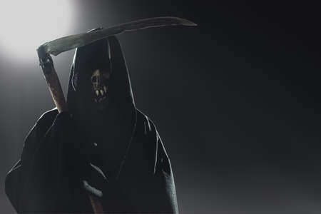 death with scythe standing in the dark photo