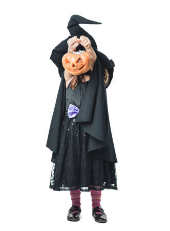 little witch shows pumpkins photo