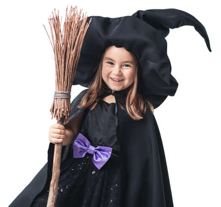 little witch with a broom on a white background photo