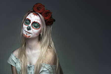 girl with a skull face makeup photo