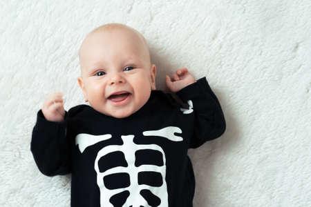 Little baby dressed funny skeleton