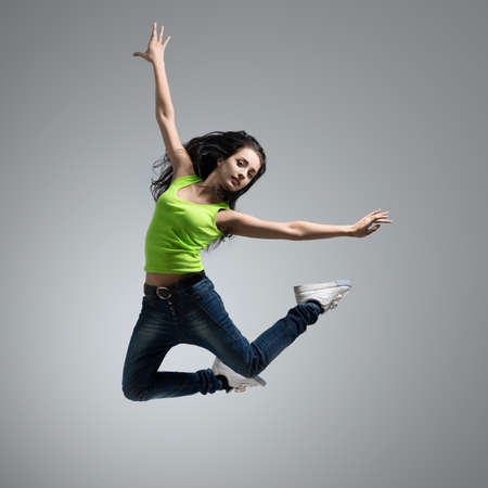 beautiful caucasian woman dancer jumping photo