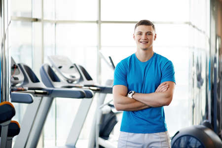young coach in the gym Stock Photo - 27567875