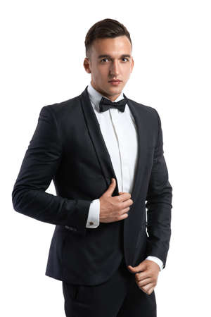 handsome business man in a suit straightens his jacket