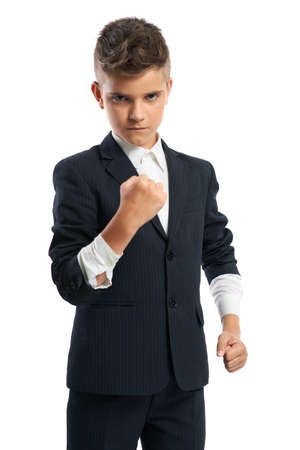 evil boy sleeves rolled up showing his fist isolated photo