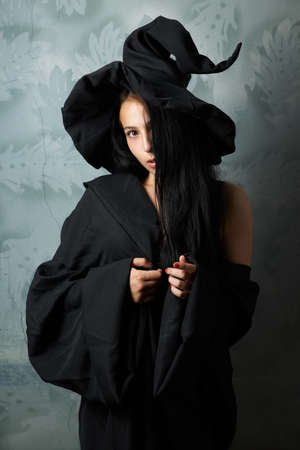 beautiful girl in a witch costume sexy looks photo