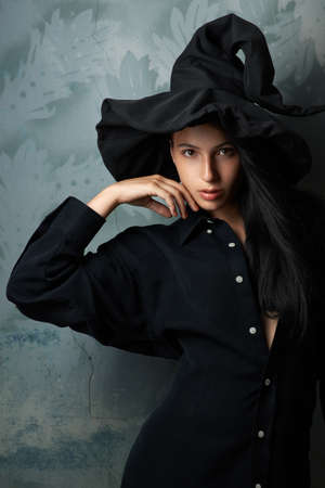 sibyl: beautiful girl in a witch costume sexy looks Stock Photo