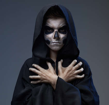 Teen with makeup closed skull scary hands photo