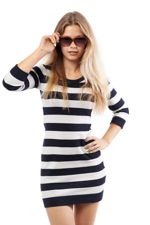 corrects: beautiful girl in a striped sweater corrects sunglasses Stock Photo
