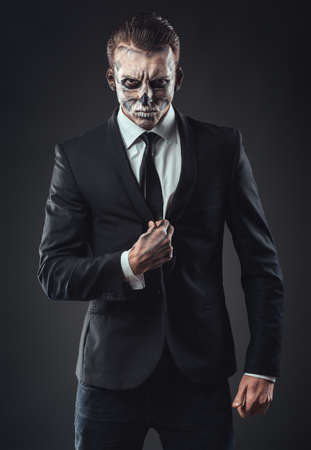 Portrait seriousbusinessman with makeup skeleton Stock Photo - 32558333