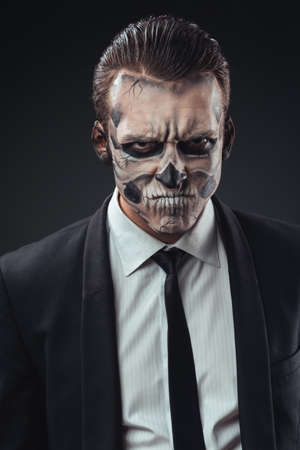 portrait of evil businessman with make-up skeleton photo