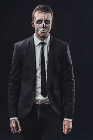 resentful businessman with a make-up of the skeleton photo