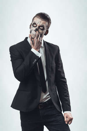 nasty businessman with make-up skeleton photo