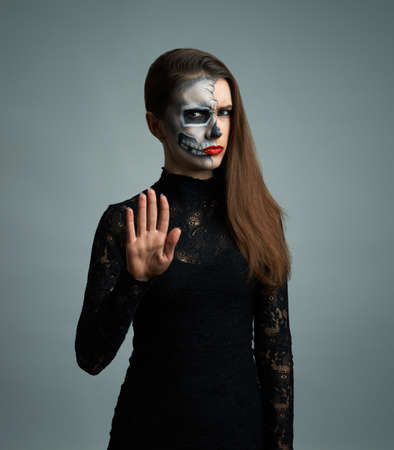 beautiful woman with make-up skeleton refuses photo
