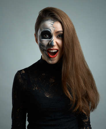 beautiful woman with make-up skeleton dumbfounded photo